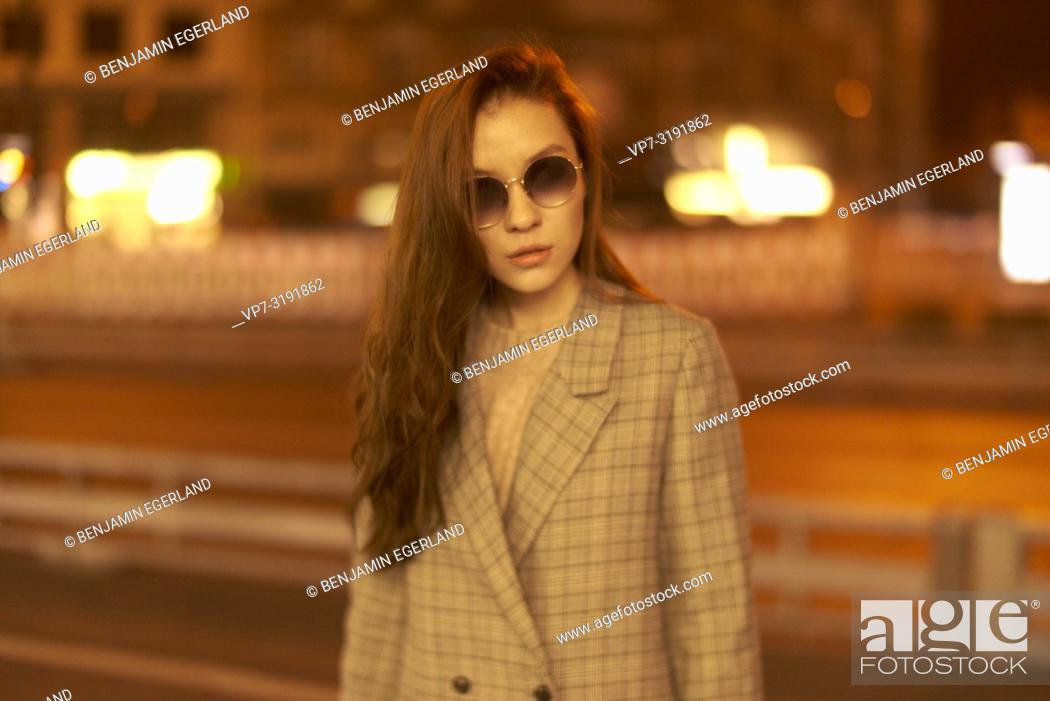 Imagen: Fashionable woman on the street by night. Munich, Bavaria, Germany.