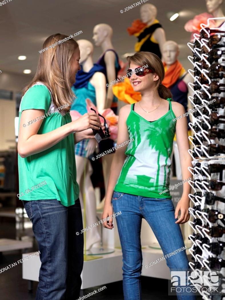 Stock Photo: Two girls trying sun glasses.