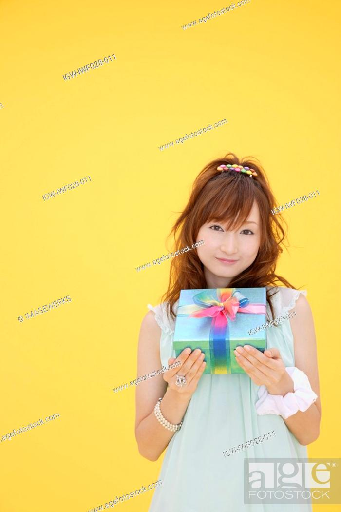 Stock Photo: Portrait of a teenage girl with a gift box.