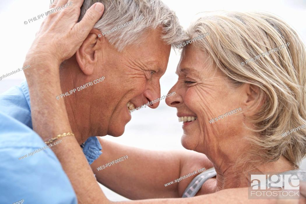 Stock Photo: Spain, Senior couple looking at each other, smiling.