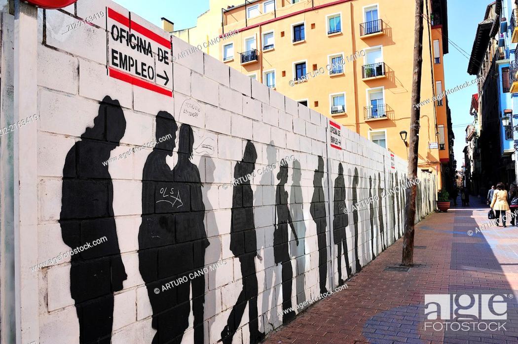 Stock Photo: Graffiti depicting a line of unemployed, Saint Paul's Quarter, Zaragoza, Spain.