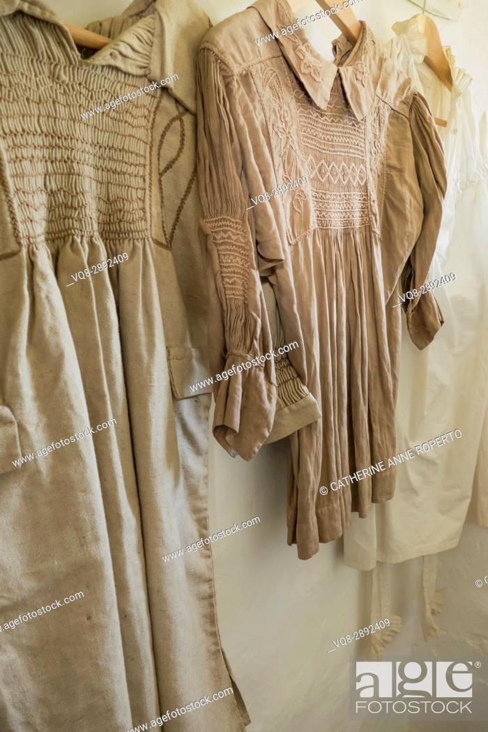 Imagen: counrty smocks with traditional embroidery hung in the laundry of a Somerset cottage in England, Uk.