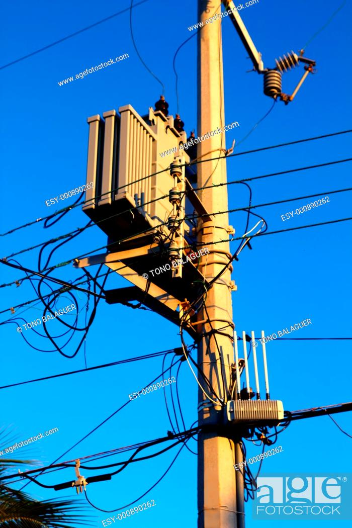 Stock Photo: light pole distribution transformer messy wires.