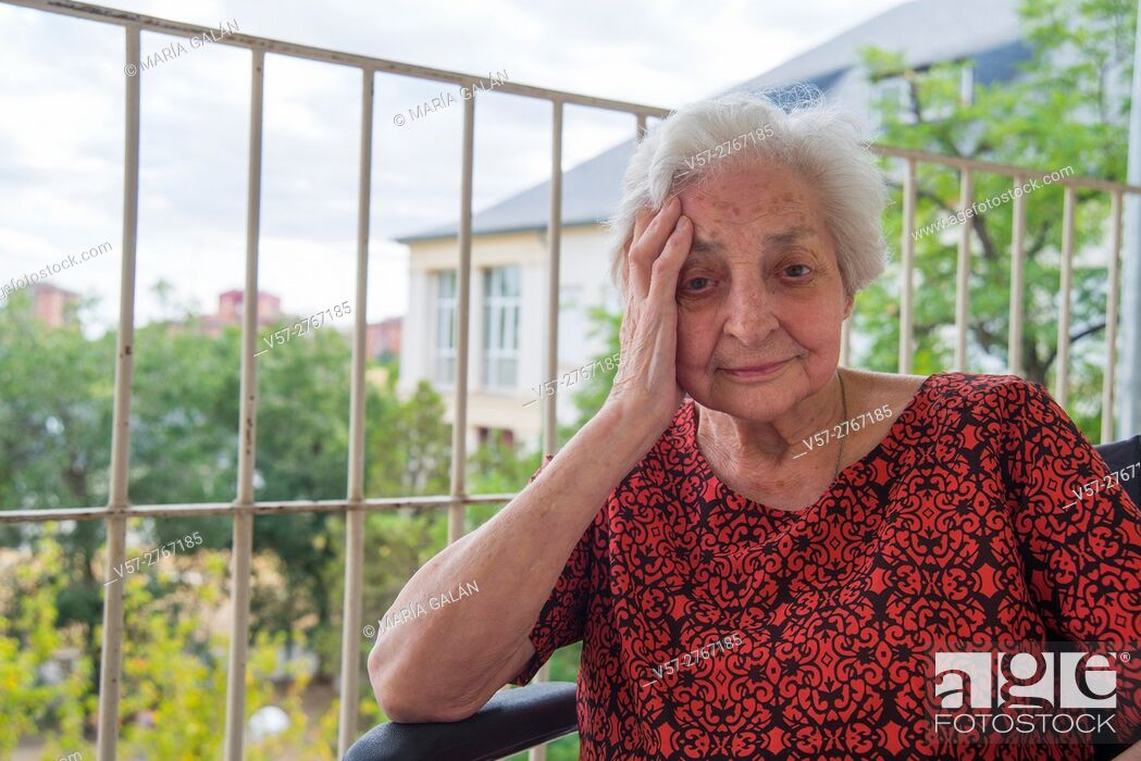 Stock Photo: Portrait of elderly woman in a nursing home, smiling and looking at the camera.