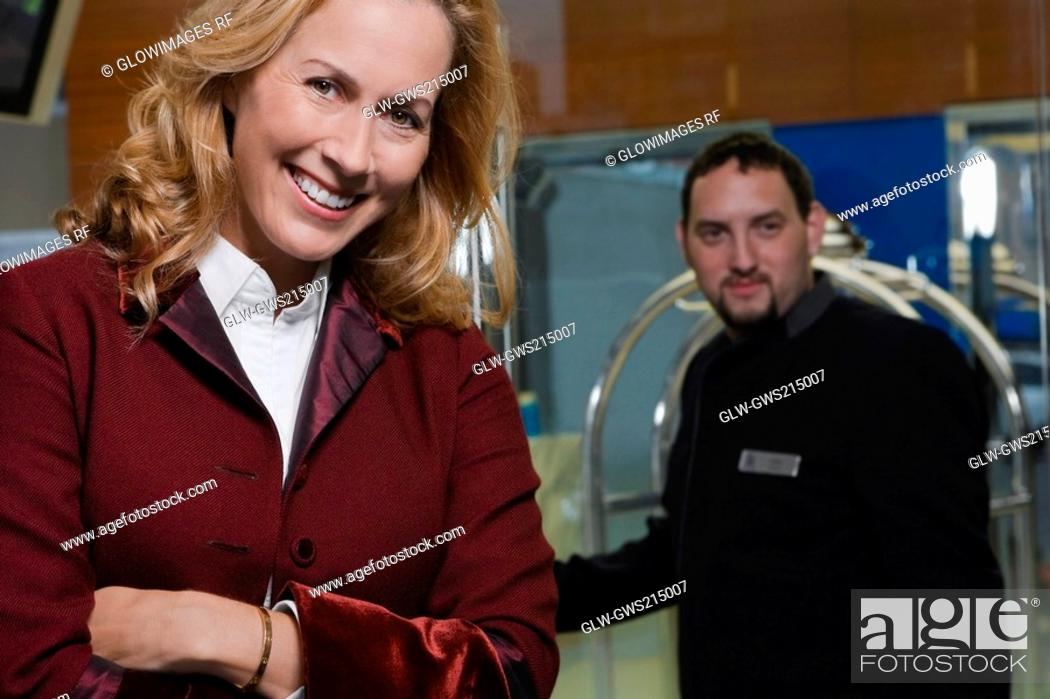Stock Photo: Portrait of a male waiter and a customer.