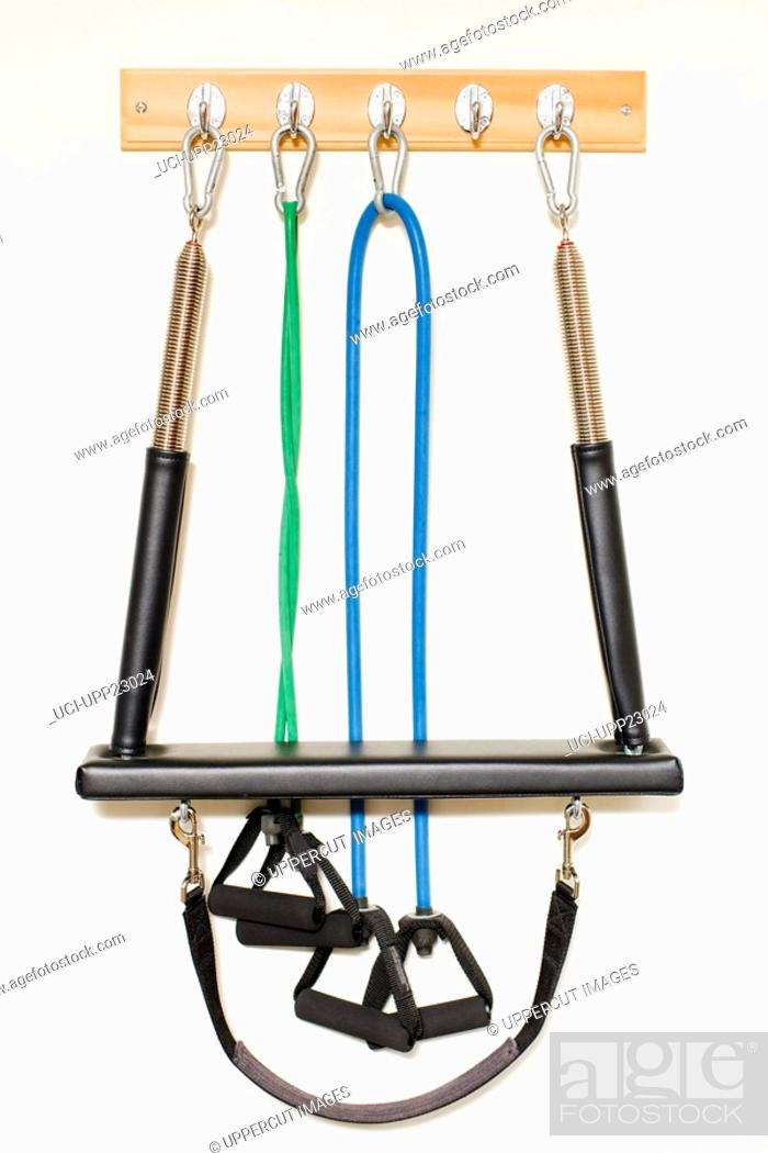Stock Photo: Resistance ropes and exercise equipment hanging from hooks.