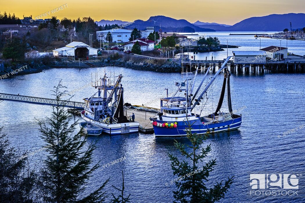 Stock Photo: Two commercial fishing purse seiners docked at work platfrom in the harbor of Sitka, Alaska, USA.