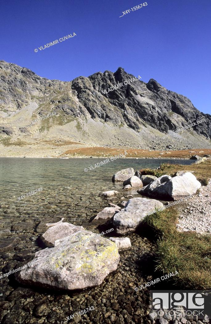 Stock Photo: Granite boulders on the shore of the largest tarn in High Tatras Slovakia - Velke Hincove pleso.