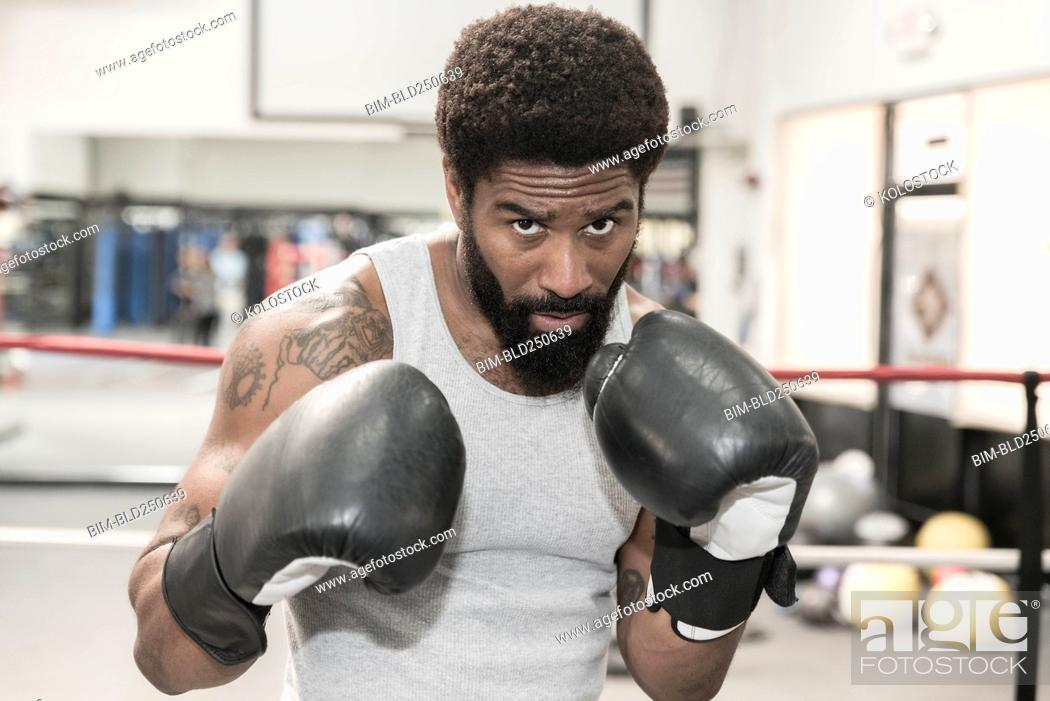 Stock Photo: Black man posing in boxing ring.