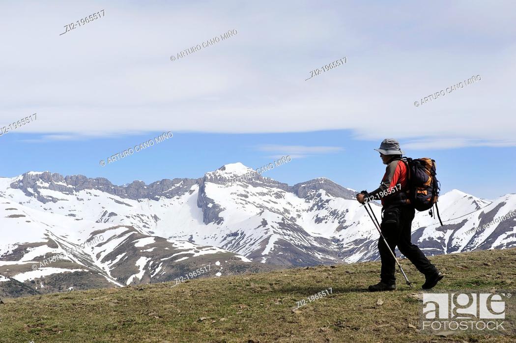 Stock Photo: Hiker in Sierra Tendeñera. Aragonese Pyrenees. Huesca, Spain.