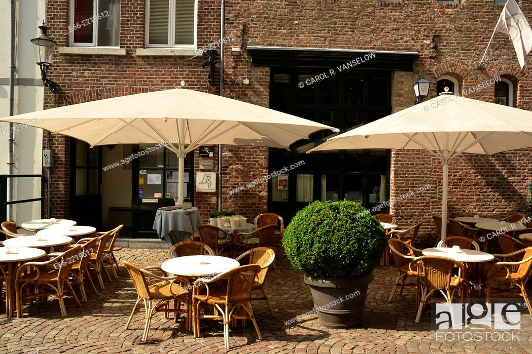 "Stock Photo: Maastricht is wellknown for its """"café/terrace culture"""" This café is located on the east bank of the Maas in Maastricht in the Netherlands."