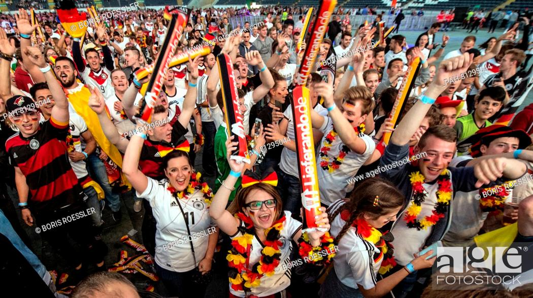 Thousands of soccer fans watch the match Germany vs Poland at a