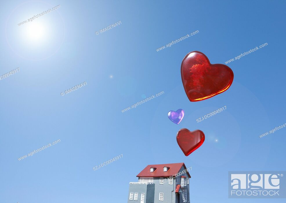 Stock Photo: Miniature house and hearts.