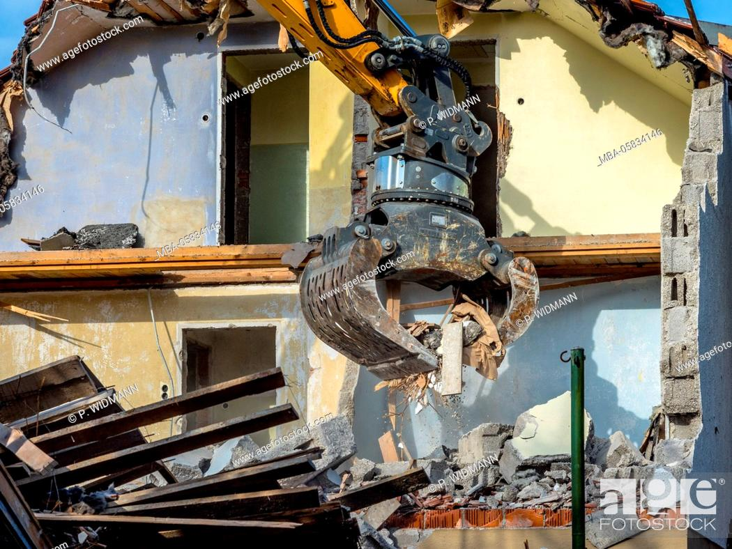 Stock Photo: Excavator with the demolition of a house, Bavaria, Germany, Europe.