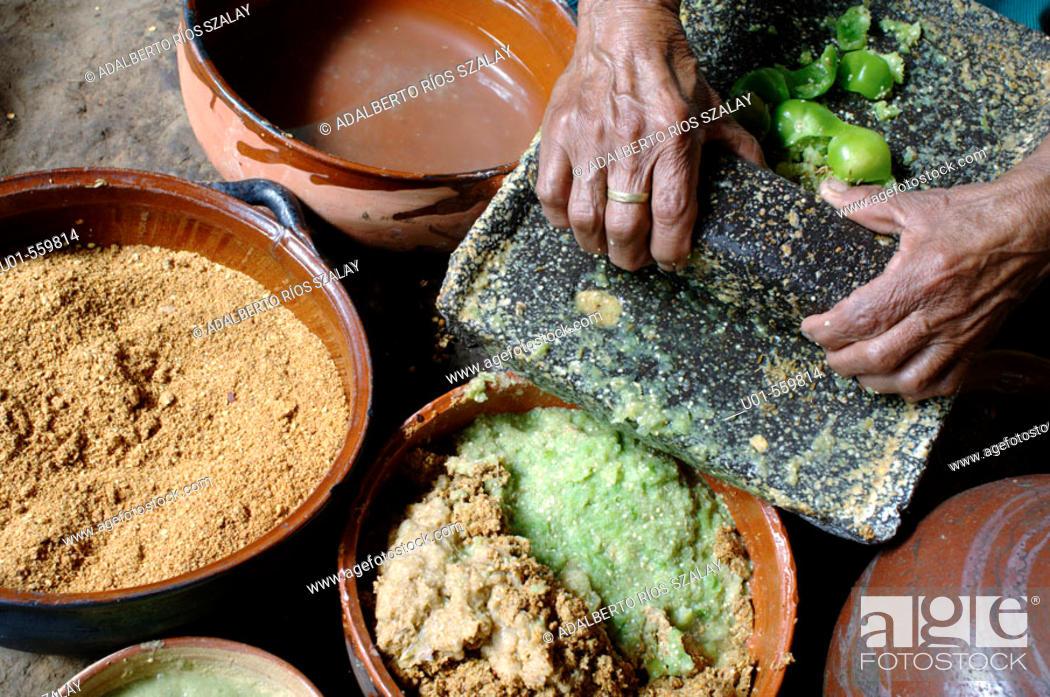 Stock Photo: Using a Metate, Michoacan Mexico.