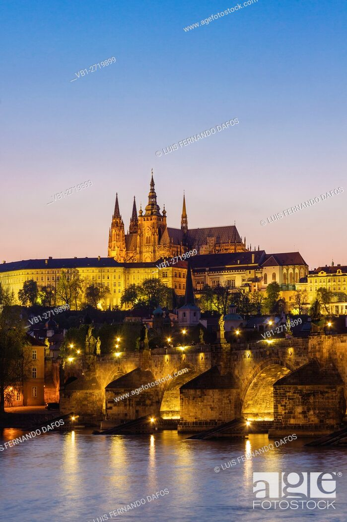 Stock Photo: Prague Castle St Vitus Cathedral Charles bridge and Vtlava River illuminated at dusk Czech Republic.