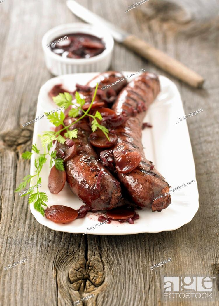 Stock Photo: Grilled sausages from Toulouse , wine, carrot and onion sauce.