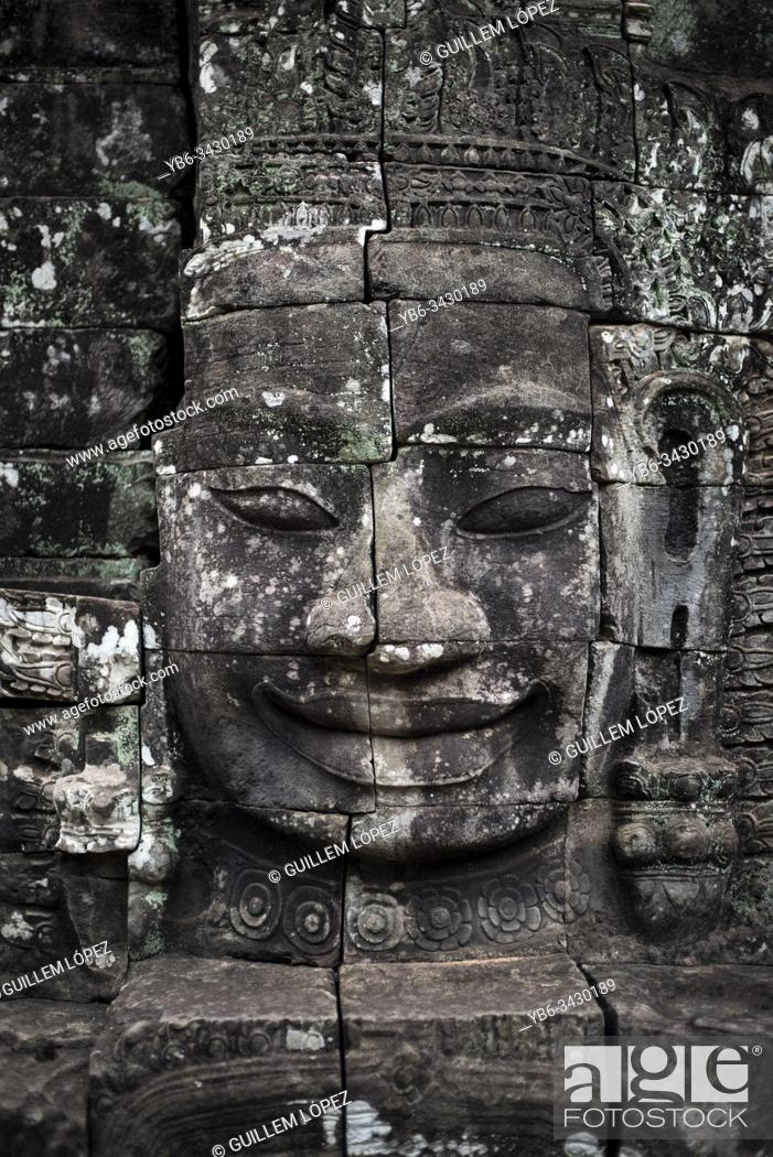 Stock Photo: Stone carved Buddha head in Bayon at the Angkor Thom temple in Angkor Wat, Siem Reap, Cambodia.