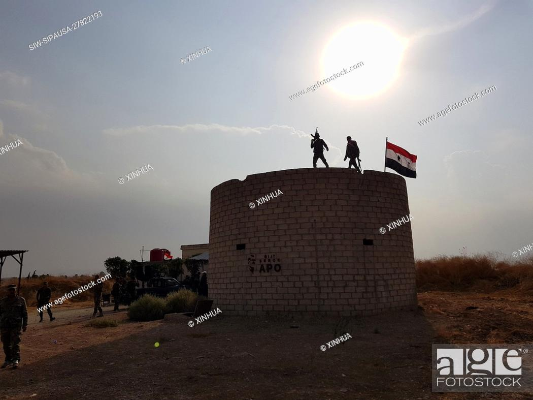 Stock Photo: (191019) -- HASAKAH (SYRIA), Oct. 19, 2019 (Xinhua) -- Syrian soldiers are seen at a previous U.S.-run military base in the village of Qasr Yalda in the western.