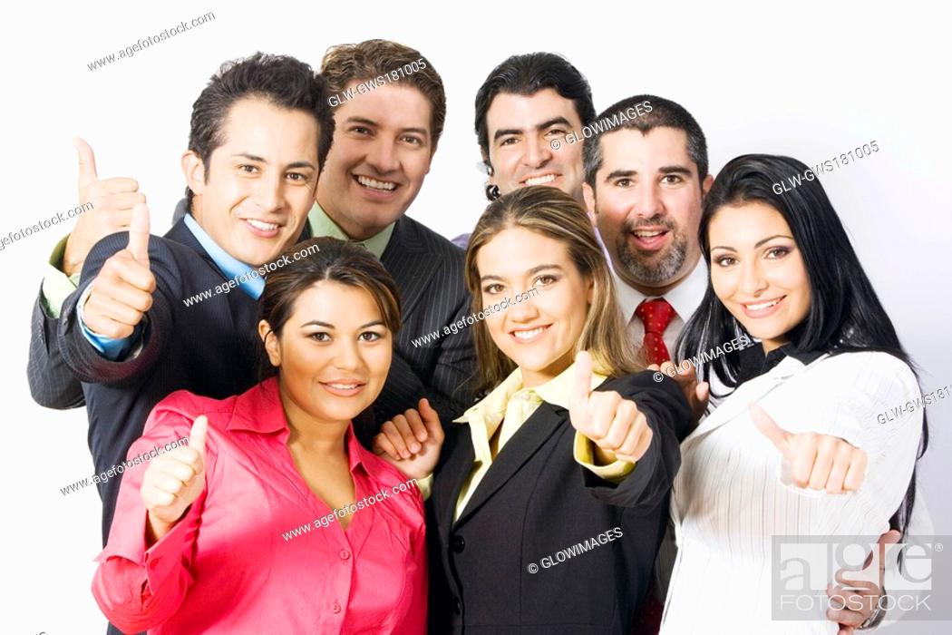 Stock Photo: Portrait of a group of business executives making thumbs up signs and smiling.