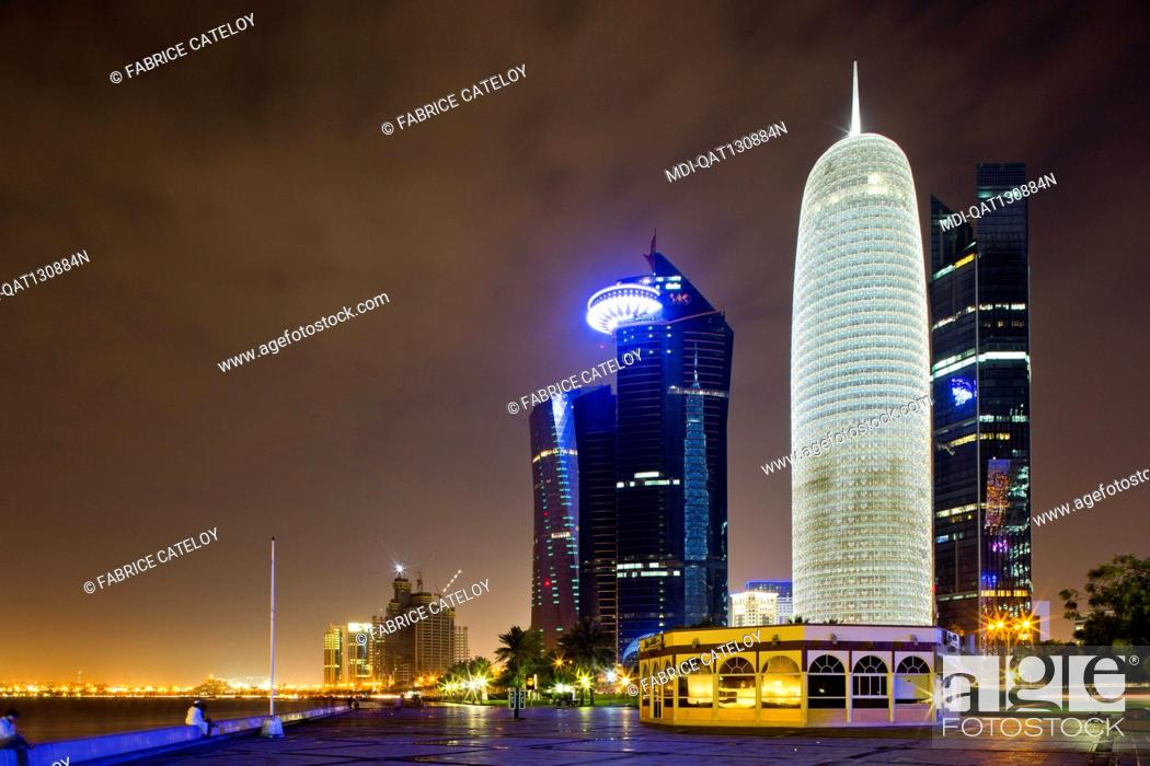 Stock Photo: Qatar - Doha - West Bay - Towers at night from the Corniche.