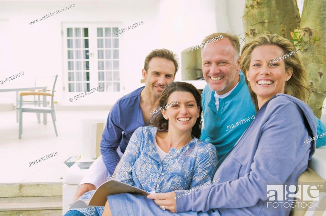 Stock Photo: Portrait of two couples smiling.