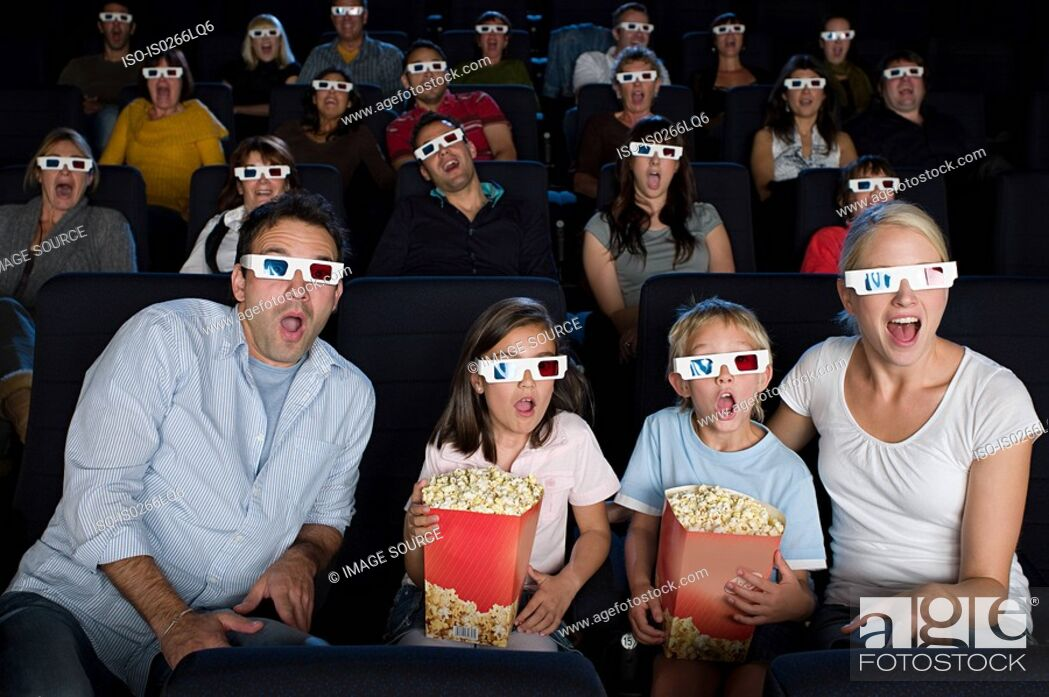 Stock Photo: A cinema audience watching a 3d movie.