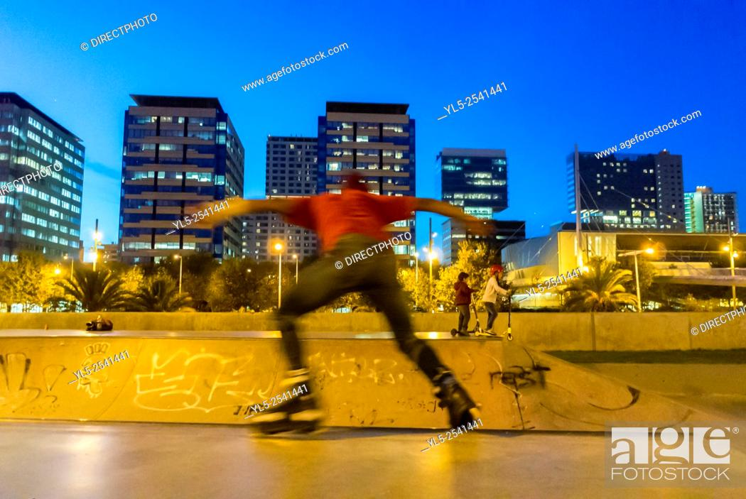 Stock Photo: Barcelona, Spain, Street Scenes, Spanish Teens Playing on Skateboards at night in Port Forum Neighborhood,.