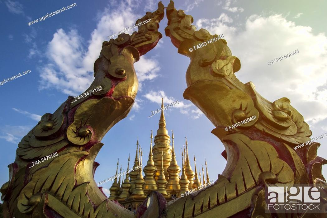 Stock Photo: Gold Pagoda at the top of the Mengle Temple in Jinghong - Xishuangbanna capital in Yunnan, China.