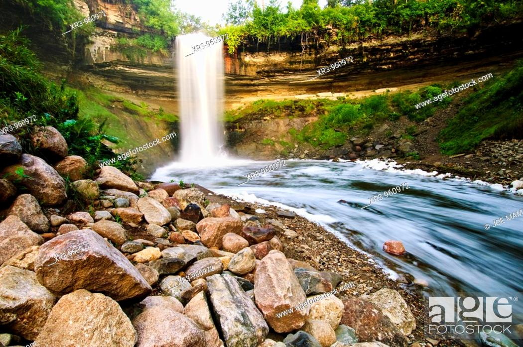 Stock Photo: 53 foot tall Minnehaha falls on Minnehaha Creek  The translation of the name is 'curling water' or 'waterfall'  The name comes from the Dakota language elements.