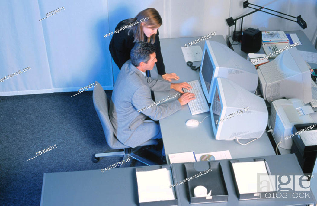 Stock Photo: Two businesspeople in front of computer, businessman typing.