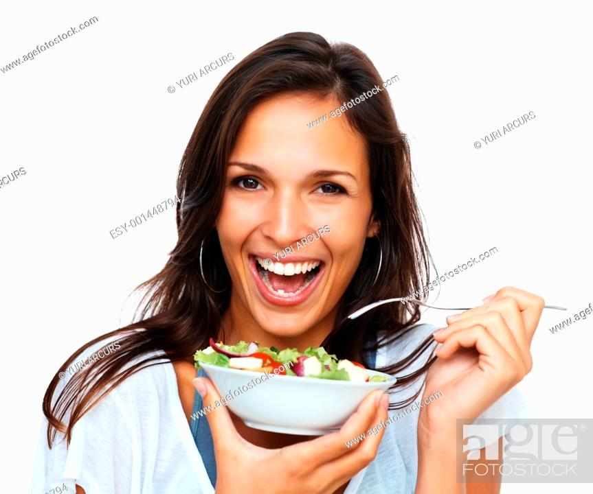 Stock Photo: Woman holding bowl of salad against white background.