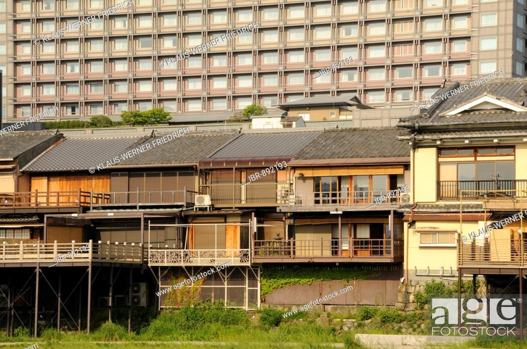 Stock Photo Traditional Anese Houses In Front Of A High Rise Apartment Building Okura Hotel Central Kyoto An Asia
