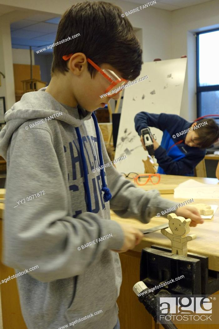 Stock Photo: 8th Grade Boys Using Tools in Technology Class, Wellsville, New York, USA.