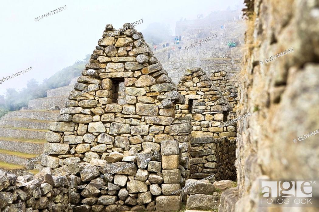 Stock Photo: Old ruins of stone structures, Machu Picchu, Cusco Region, Peru.