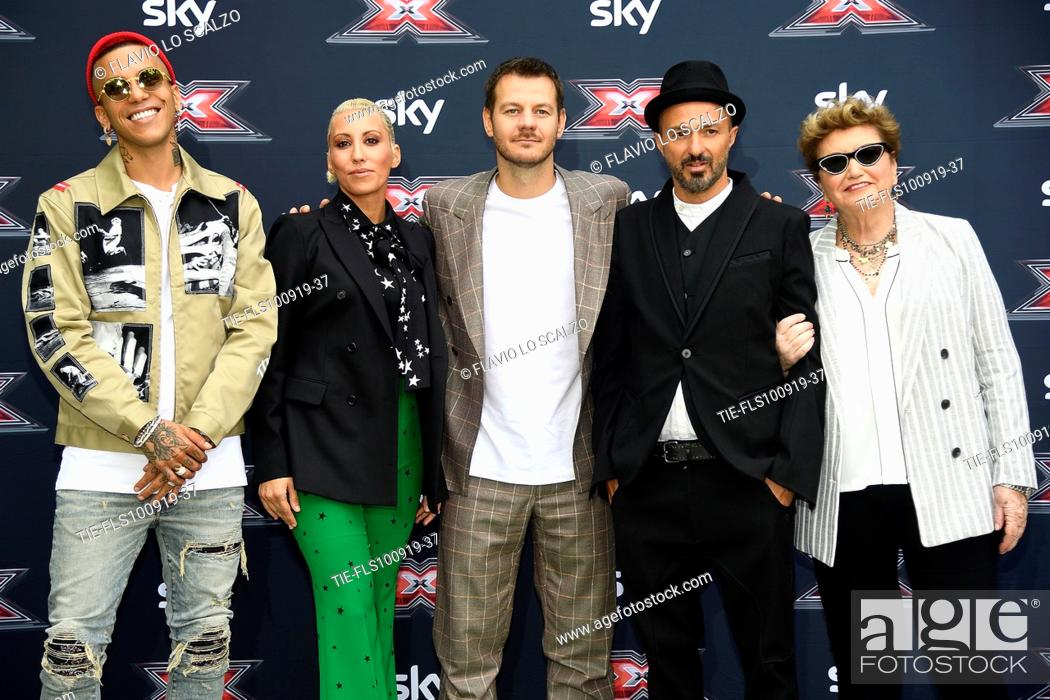 Stock Photo: Rapper Sfera Ebbasta, singer Malika Ayane, tv conducer Alessandro Cattelan, singer Samuel, record producer Mara Maionchi during the photocall of X Factor 2019.