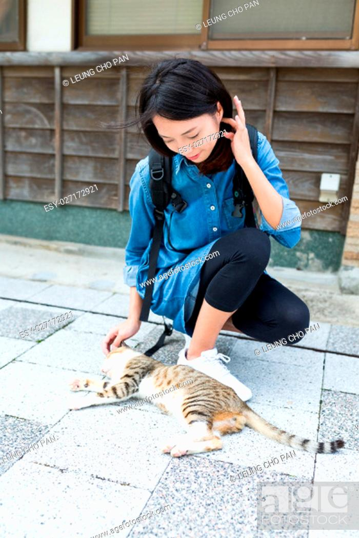 Stock Photo: Woman play with cat at outdoor.