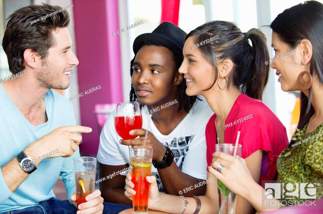 Stock Photo: Friends with drinks in a restaurant.