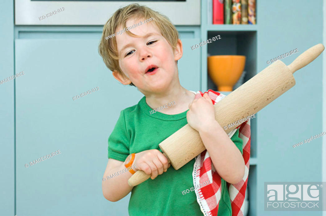 Stock Photo: Boy with a rolling pin.