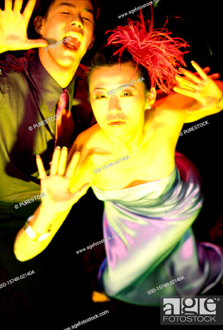 Stock Photo: High angle view of a young couple dancing in a nightclub.
