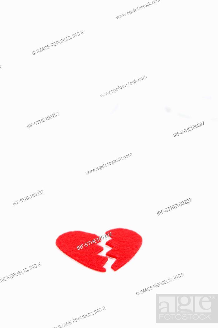 Stock Photo: broken glass and heart shape.