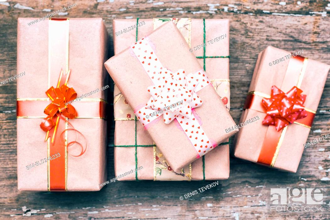 Stock Photo: Gift boxes on wooden table.