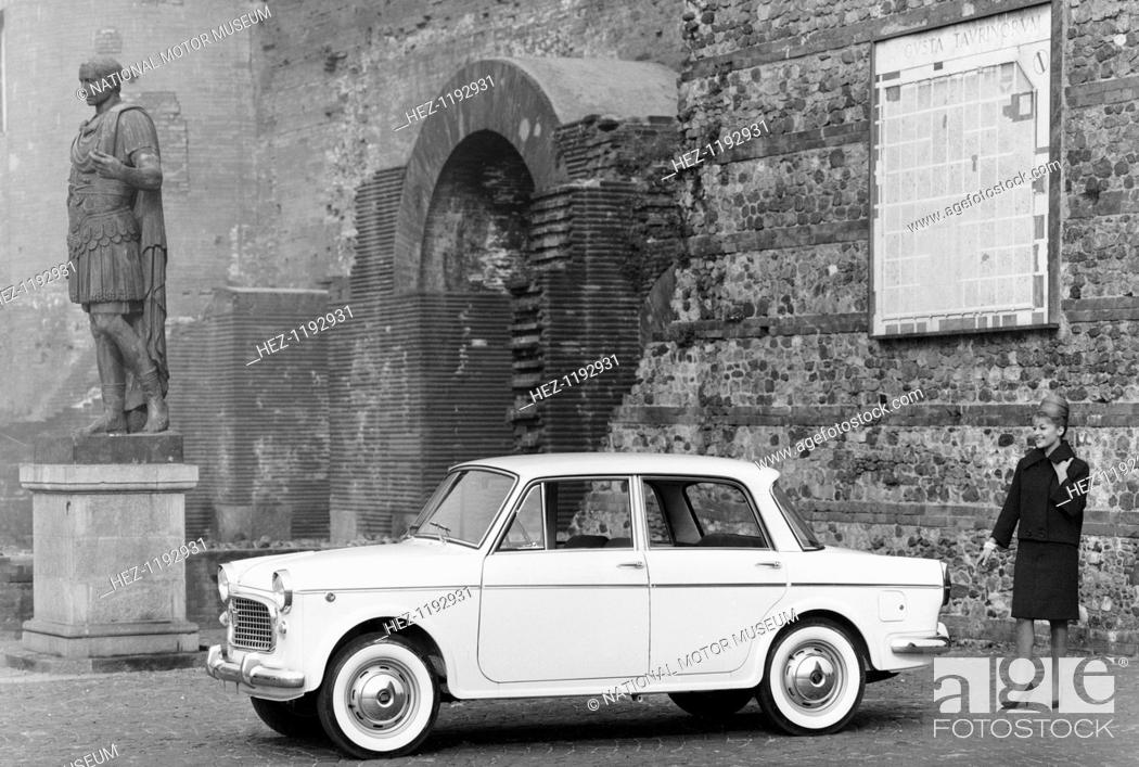 Stock Photo: 1963 Fiat 1100 Speciale, 1960s. Parked by a Roman statue.