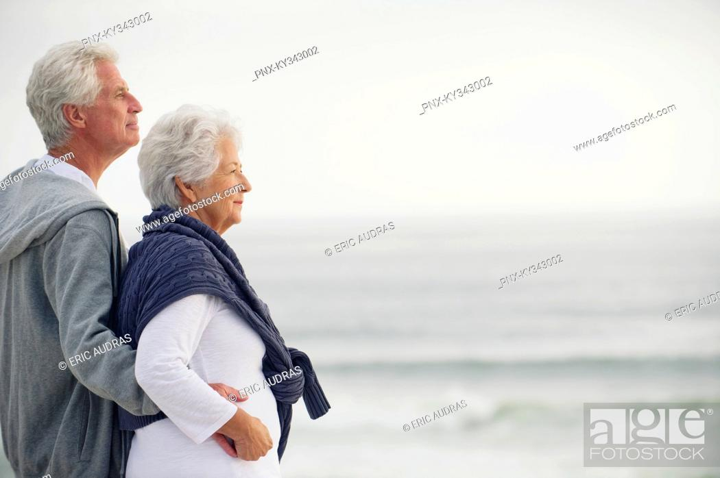 Stock Photo: Side profile of a senior couple looking at the sea.