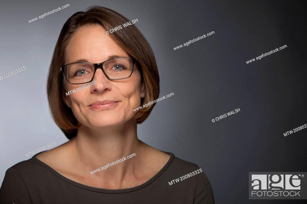 Stock Photo: Woman portrait smiling glasses mature middle aged.