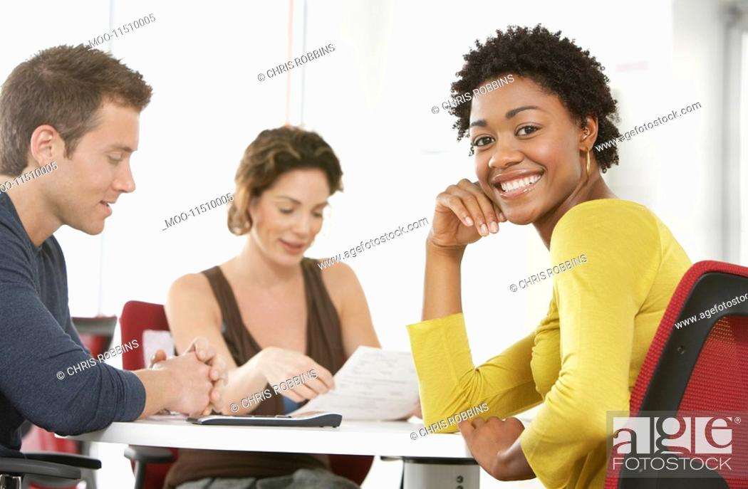 Stock Photo: Business colleagues in office meeting portrait.