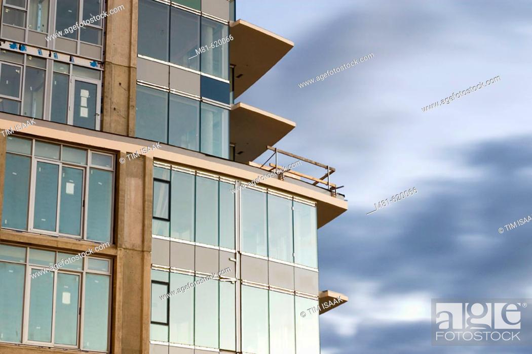 Stock Photo: Condominium building under construction. Sidney, British Columbia, Canada, 25 November 2006.