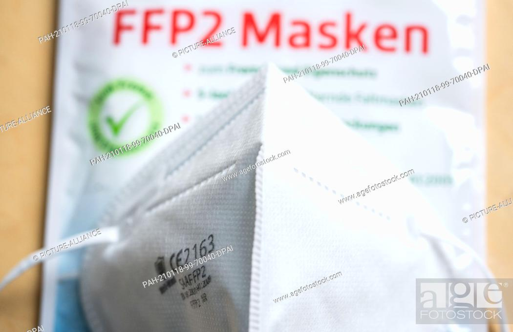 Stock Photo: 18 January 2021, Hessen, Frankfurt/Main: ILLUSTRATION - An FFP2 mask sits on a table at the sales concession. To protect against the coronavirus.