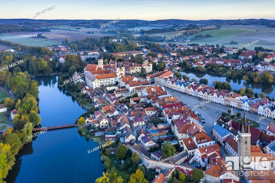 Stock Photo: Aerial view before sunrise of the town of Telc with its castle, square, ponds and rolling hills in the Czech Republic.