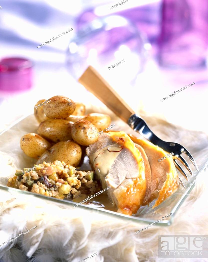 Stock Photo: Turkey with dried fruit and saffron sauce.